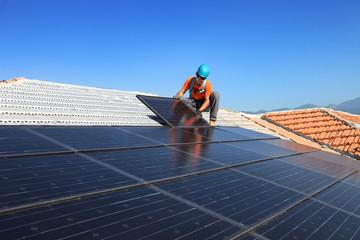 installing alternative energy photovoltaic solar panels