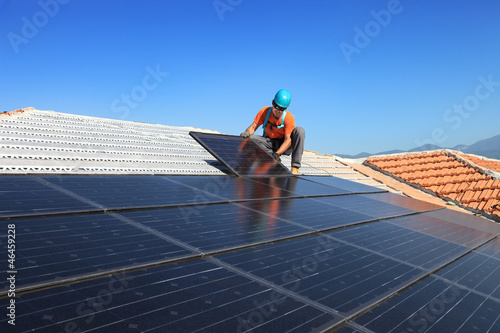 Leinwandbild Motiv installing alternative energy photovoltaic solar panels