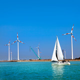 Yacht in the sea and wind turbines.