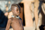 Closeup portrait of proud Himba boy looking away.