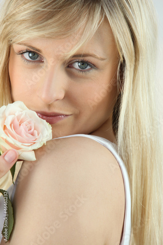 blonde woman and a rose