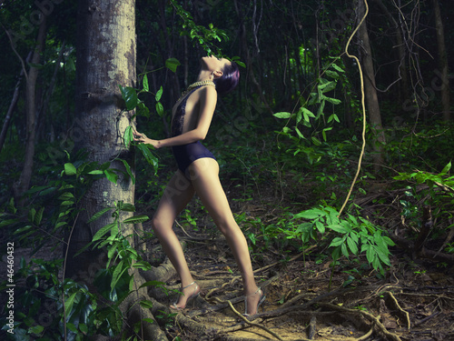 Glamorous lady in a tropical forest - 46460432