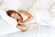 young beautiful woman sleeping on bed in bedroom