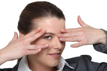 portrait of a woman hiding her eyes