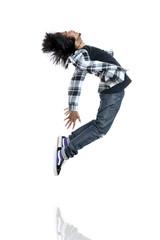 Hip hop dancer jumping on white.