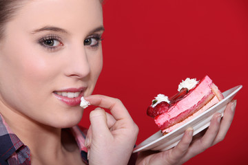 Woman tempted by a piece of cake