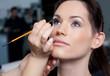 Make up artist applying make up to a fashion model/bride.