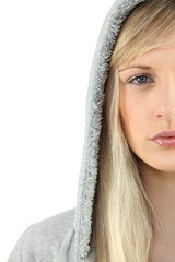 Young woman in a grey hooded sweatshirt