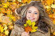 Smile in autumn leaves