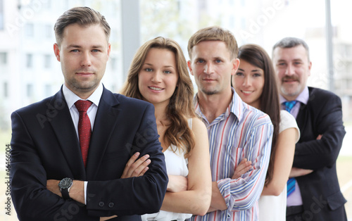 Group portrait of a professional business team looking at camera