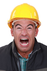 Portrait of construction worker screaming