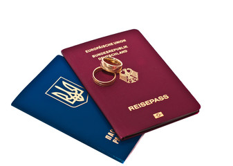 Gold rings of a newly-married couple and the passport