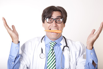 Funny young doctor eating a carrot