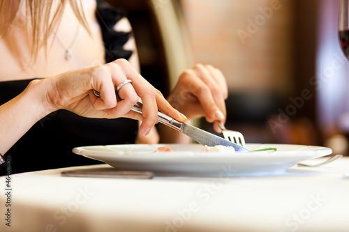 Woman having dinner at restaurant