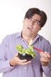 Handsome casual man eating salad