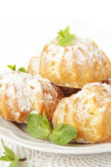 Profiteroles with cream and powdered sugar