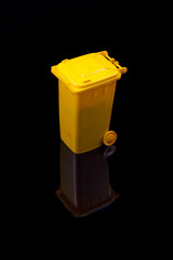 yellow trash, isolated in black