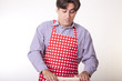 Handsome casual male cook with cooking equipment