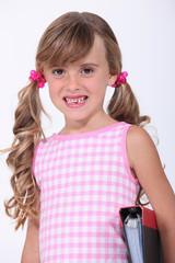 Young schoolgirl showing her teeth
