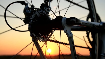 Derailleur of racing bike at sunset