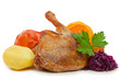 Roast duck with red cabbage and apples.