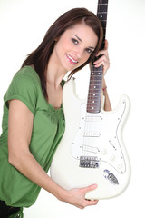 Pretty girl holding guitar