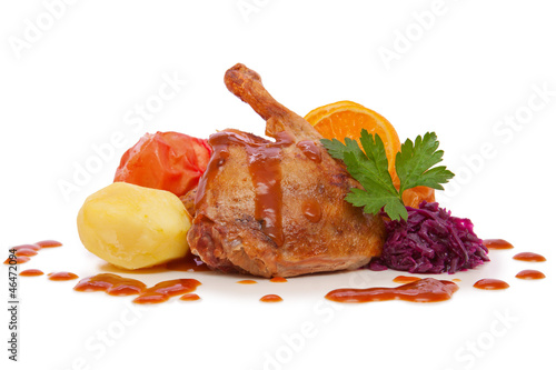 Roast goose leg with red cabbage and apples.