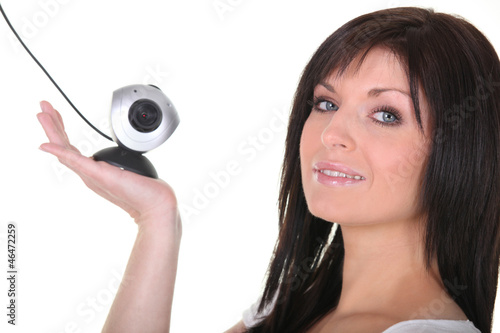Woman holding web cam