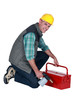 craftsman holding his tool box and welding torch