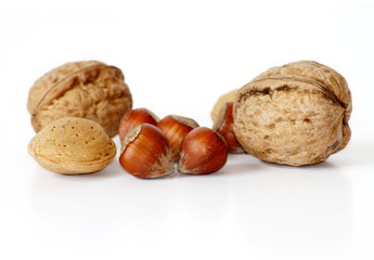 Nuts with shells isolated on white