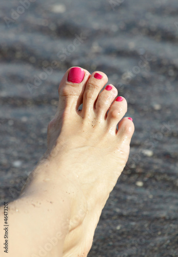 Female foot with pink nail polish