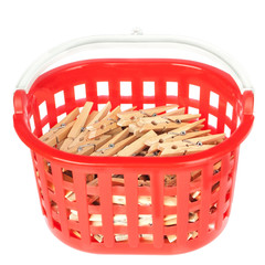 Set of pegs clothespins in the red basket. On a white background