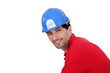 Man wearing a blue hardhat