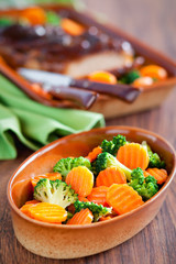 Salad of boiled carrots and broccoli with spicy orange dressing
