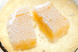 Horizontal shot of a plate with honeycomb slices and fresh honey