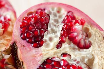 Horizontal shot of a sliced pomegranate, close-up