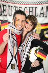 Young couple supporting the German national team