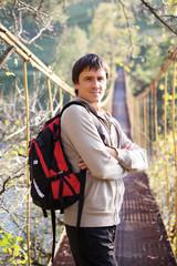 Man tourist on a suspension bridge