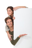 Couple stood by blank message board
