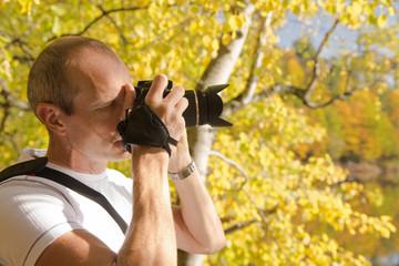 man makes in autumn photo
