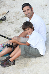 father and son at fishing party