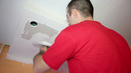 Man Applaying Plaster on a Dry Wall