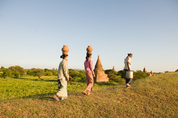traditional farmers at myanmar, bagan carrying pots