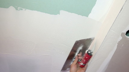 Applying Plaster to Dry Wall