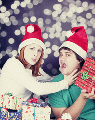 Girl strangling her boyfriend for a christmas gift.