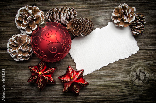 Christmas greeting card on wooden top