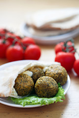 Falafel balls with pita bread,sauce,salad and tomatoes