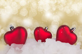 Abstract Christmas gold background with red balls on the snow