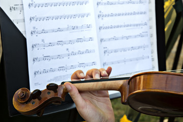 Wooden Violin and Sheet Music