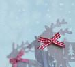 Rentiere im Schneefall